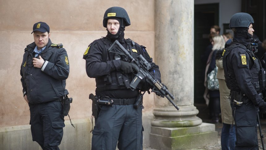 Danish police stand guard at the city court, during a trial of those arrested in connection with the February 2015 shooting attacks at a free speech event and a synagogue, in Copenhagen
